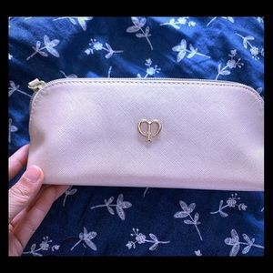New Cle De Peau makeup bag in shiny cream color